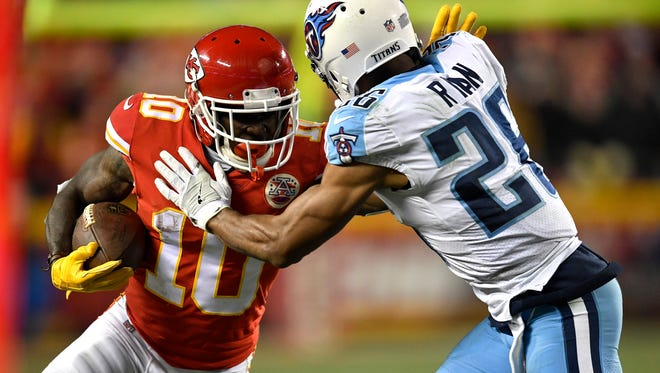 Chiefs wide receiver Tyreek Hill (10) is pushed out of bounds by Titans cornerback Logan Ryan (26) during the second half of an AFC wild-card game Saturday at Arrowhead Stadium.