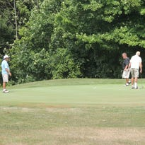Brian Sand (left) watches Logen Sand's shot at the Golf Club of Bucyrus on Friday afternoon.