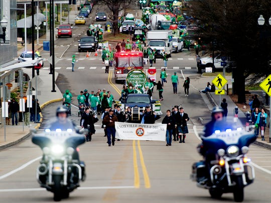 The parade makes its way down Howard Baker Jr. Blvd. during the Knoxville St. Patrick's Day Parade in downtown Knoxville, Tennessee on Friday, March 17, 2017. After an almost 30-year absence, the Knoxville St. Patrick's Day parade returned in 2017.