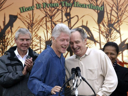 Bill Clinton, left, greets Sen. Tom Harkin at the senator's annual steak fry Saturday in Indianola on Spet. 13, 2003. Clinton gave the keynote address.