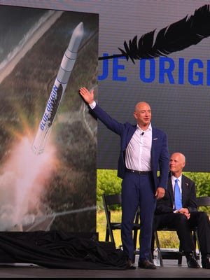 At Cape Canaveral Air Force Station's Launch Complex 36 on Sept. 15, 2015, Amazon.com founder and CEO Jeff Bezos announced that his space company, Blue Origin, would build New Glenn rockets at Kennedy Space Center's Exploration Park and launch them from the Cape. Florida Gov. Rick Scott looked on at right. U.S. Sen. Bill Nelson also shared the stage.
