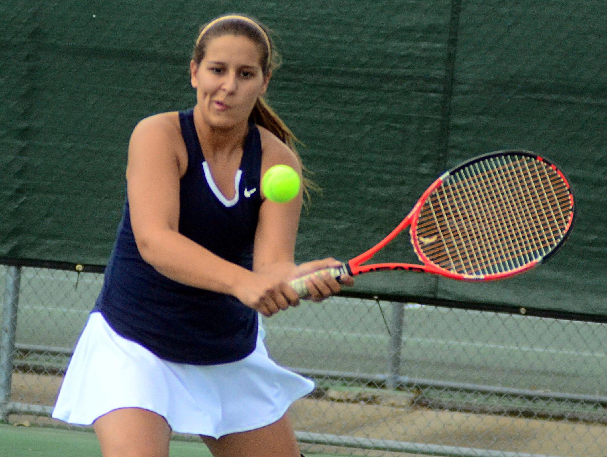 Beech High senior Courtney Brooks returns a serve during Wednesday's doubles semifinals.