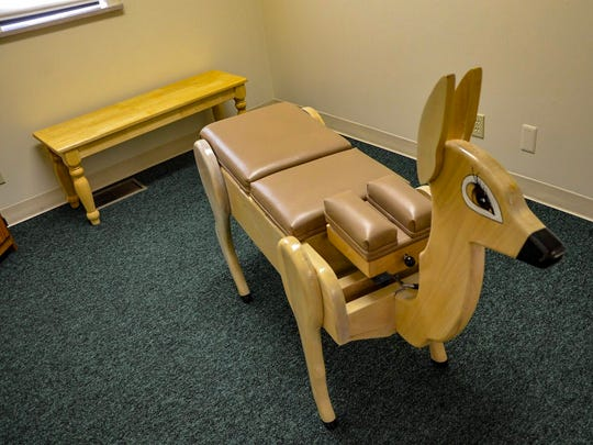 Grassroots Family Chiropractic has a chiropractic table for children that looks like a deer.