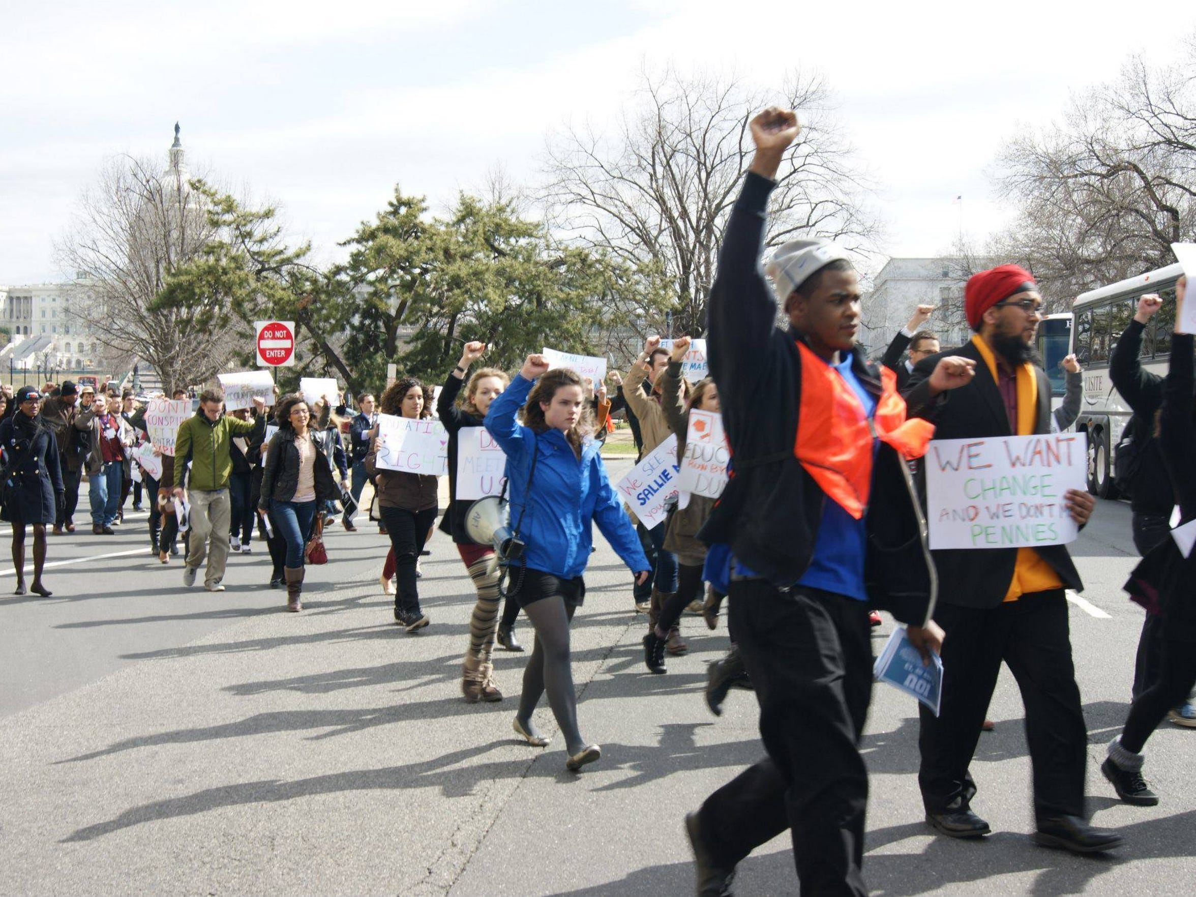 Lamonte Moore walks in a protest about student loan