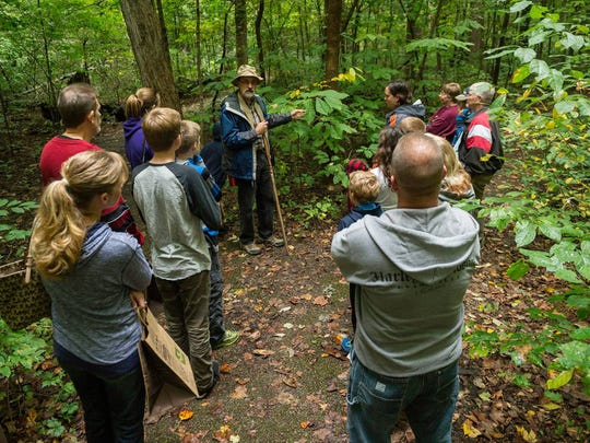 Indiana Master Naturalist Gary Frank leads guests on a fall foliage hike through Wesselman Woods during Harvest Festival last year. Photo by Bob Gwaltney