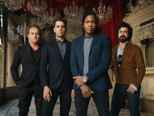 The Newsboys, including lead singer Michael Tait, foreground,
