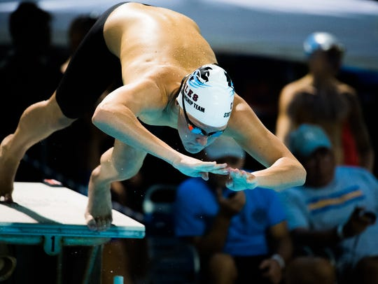 Chiles' Cole Forbes dives into the pool during Saturday's