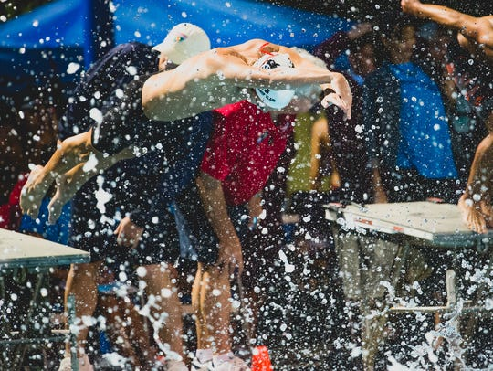 Chiles' Parker Brown dives into the pool during Saturday's