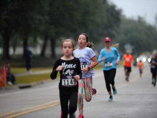 Children run together at the annual Turkey Trot in Southwood.
