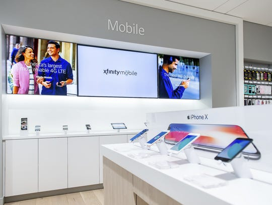 The new Xfinity stores being rolled out by Comcast allow customers to tap into free Wi-Fi with in store tablets and other smart devices.