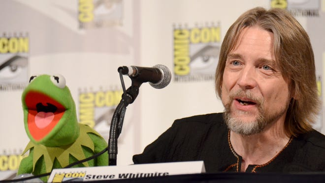 Kermit the Frog, left, and puppeteer Steve Whitmire attend 'The Muppets' panel during Comic-Con International in San Diego.