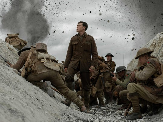"""George MacKay (center) as a young British soldier who has to relay an important message in the World War I movie """"1917."""""""