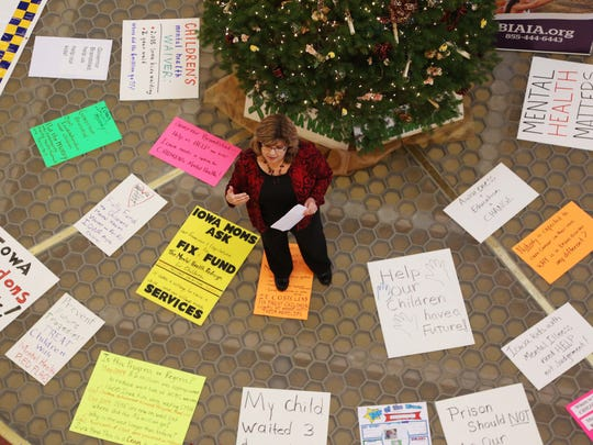 Kim Jensen, 52, of Cedar Falls speaks at a rally calling