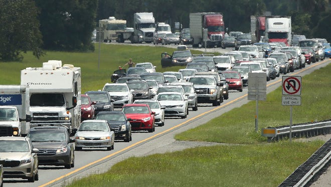 Traffic rolls slowly on Friday on the northbound lanes of Florida's Turnpike near the intersection of I-75 in Wildwood, Fla., as Floridians flee before the arrival of Hurricane Irma.