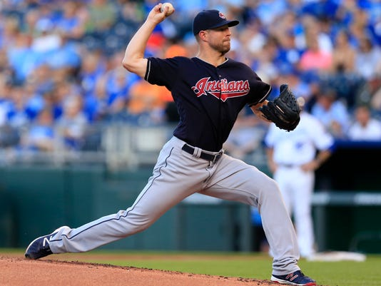 Cleveland Indians starting pitcher Corey Kluber delivers to a Kansas City Royals batter during the first inning of a baseball game at Kauffman Stadium in Kansas City, Mo., Wednesday, June 15, 2016. (AP Photo/Orlin Wagner)
