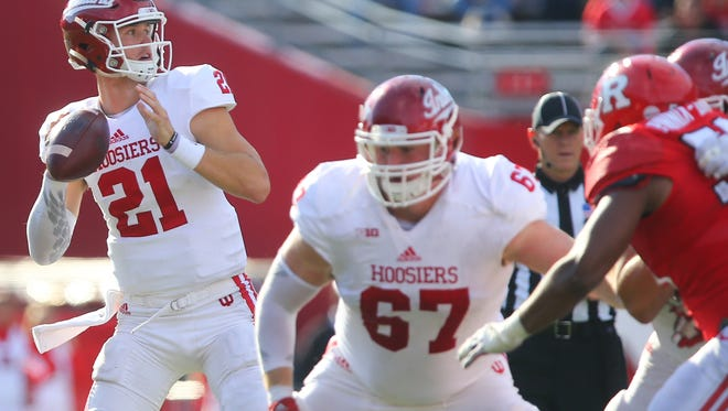 Hoosiers quarterback Richard Lagow (21), throwing a pass during the second half Saturday against Rutgers, helped his team recover from a difficult first half.