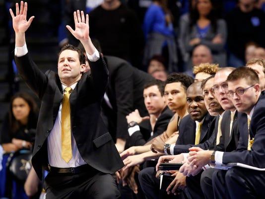 Vanderbilt head coach Bryce Drew, left, calls a play during the second half of an NCAA college basketball game against Kentucky, Tuesday, Feb. 28, 2017, in Lexington, Ky. Kentucky won 73-67. (AP Photo/James Crisp)