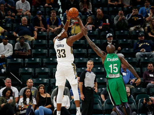 Indiana Pacers center Myles Turner (33) takes a shot against Maccabi Hafia center Brandon Bowman (15) at Bankers Life Fieldhouse.