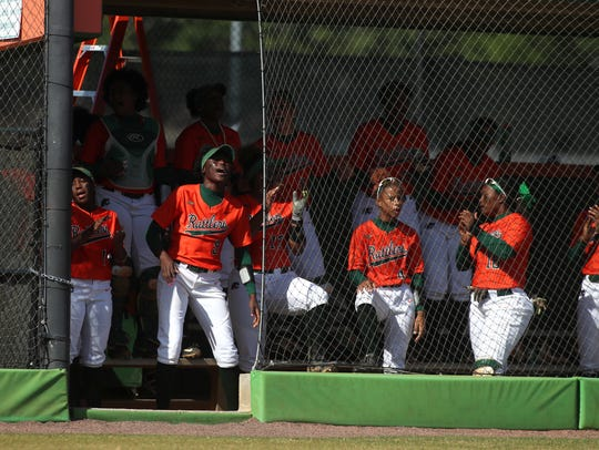 FAMU players cheer from the bench during the first