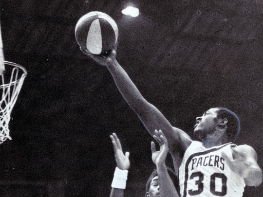 George McGinnis (30) starred at IU for a season before