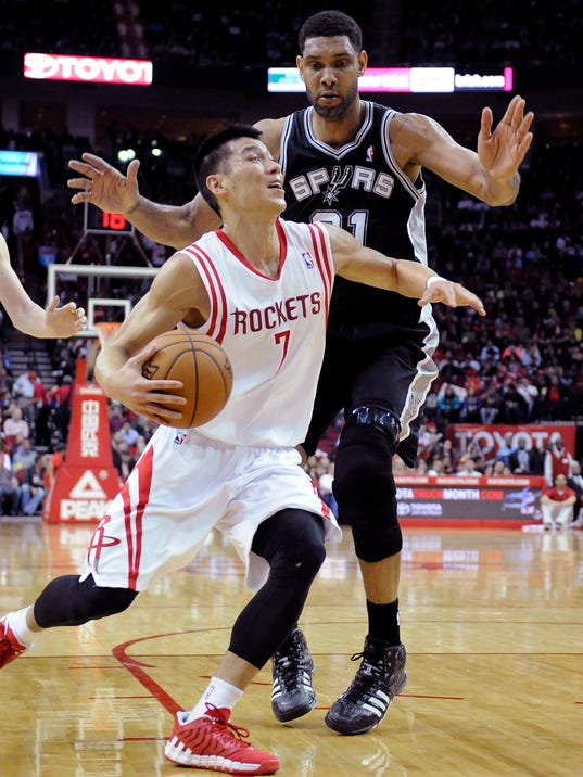 Houston Rockets' Jeremy Lin (7) drives the ball past San Antonio Spurs' Tim Duncan (21) in the first half of an NBA basketball game Monday, April 14, 2014, in Houston. (AP Photo/Pat Sullivan)