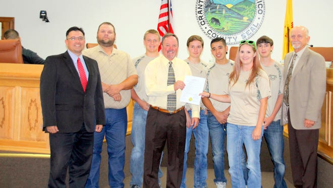 The 4-H High Point Shooting Team at state was recognized with a County Commission proclamation. From left are Commissioner Gabriel Ramos, Coach Shawn Brabson, team member Riley Brabson, Commission Chairman Brett Kasten, team members Trent Kasten and Jordan Gonzales, Extension Agent Jessica Swapp, team member Ty Dalton, and Commissioner Ron Hall.