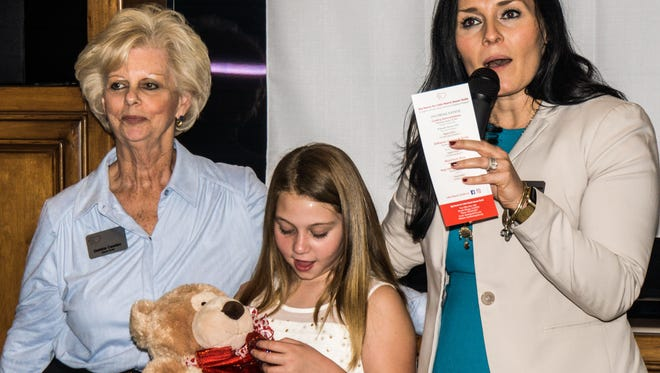 Guild member Debbie Casden, her granddaughter Olivia Casden and assistant vice president Loma Linda University Health Jillian Payne.