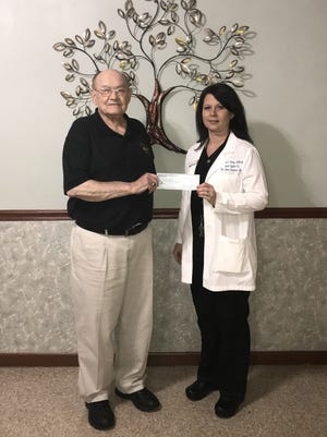 Elks President Stuart Friend recently presented a $500 donation from theMountain Home Elks Lodge to Brandi Sharp, APRN, Executive Director of the Mountain Home Christian Clinic. The clinic provides healthcare to those who for various reasons cannot afford or are not being served by the established system.