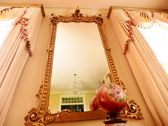 Killarney Farm's 19th century gold leaf  framed French mirror in the formal living room,