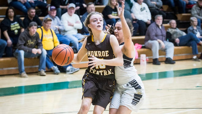 Monroe Central's Hannah Bolton powers past Madison-Grant's defense during their game at Eastern High School in Greentown Saturday, Feb. 11, 2017.