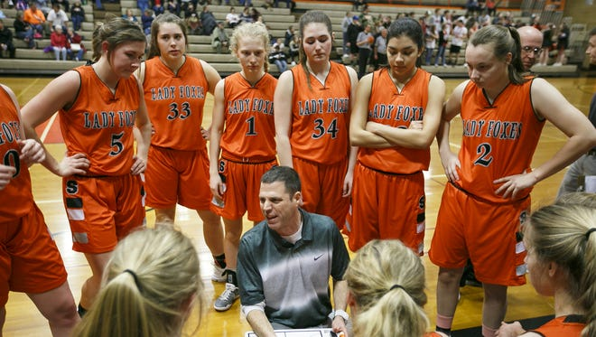 Silverton coach Tal Wold talks to the team at the end of the first quarter against Dallas on Wednesday, Feb. 15, 2017, at Dallas High School. After a close second half, Silverton won the game 35-33.