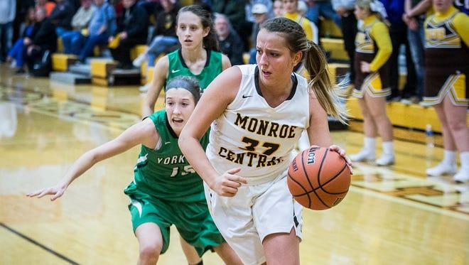 Monroe Central's Abigail McGrath drives against Yorktown at Monroe Central High School Saturday, Dec. 7, 2017.
