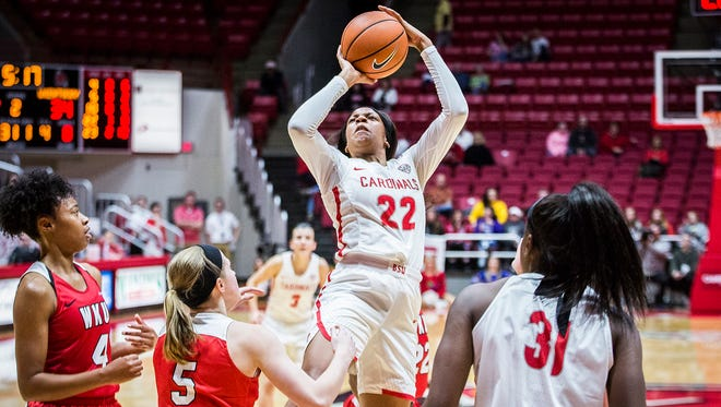 Ball State's Destiny Washington, shown here earlier this season against Western Kentucky, is out with a knee injury.