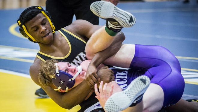 Cowan's DJ Bell wrestles Central's Jacob Prybylla during wrestling sectionals at Delta High School Saturday, Jan. 27, 2018.