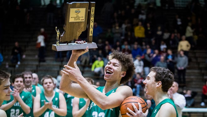 New Castle celebrates defeating Delta in the sectional championship game at New Castle High School Saturday, March 3, 2018.