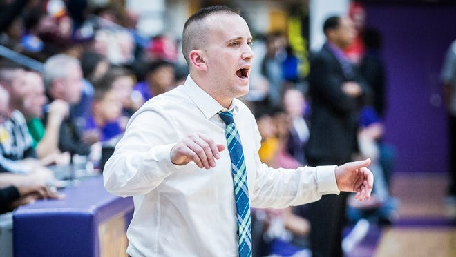 New Castle's Daniel Cox coaches against Marion in their regional championship game at Marion High School Saturday, March 10, 2018.