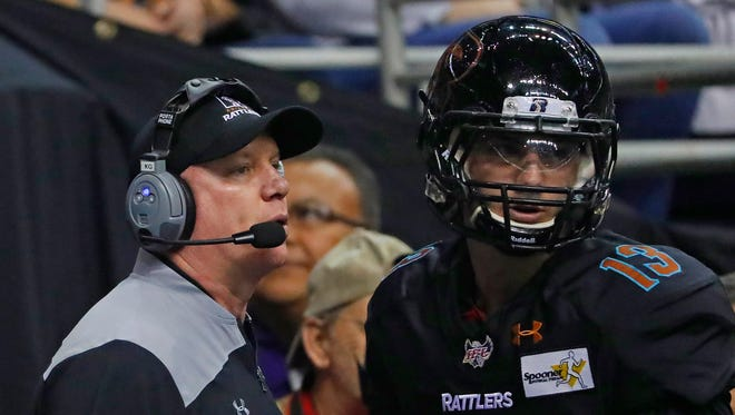 Rattlers head coach Kevin Guy talks with quarterback Jeff Ziemba (13) during the first half at Talking Stick Resort Arena on February 25, 2018 in Phoenix, Ariz.