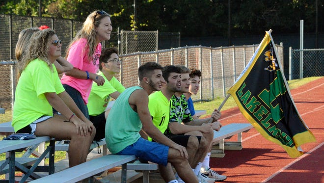 Lakeland soccer tans watch the Hornets play a recent game at Somers.