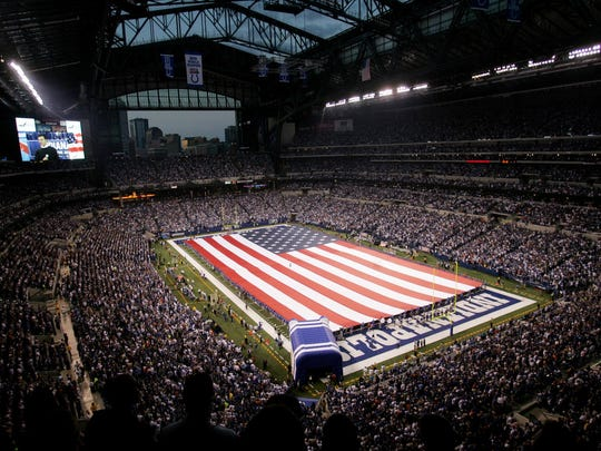Workers that helped build Lucas Oil Stadium hold a giant American Flag on the field during the National Anthem sang by Johnny Mathis before the Colts game against the Chicago Bears at Lucas Oil Stadium in Indianapolis, Sunday, September 7, 2008. (Heather Charles/The Star)