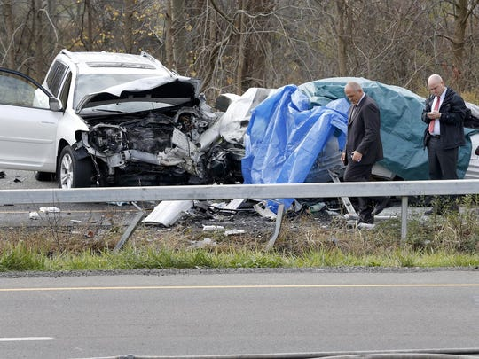 In a Nov. 2 photo, police investigate the crash site