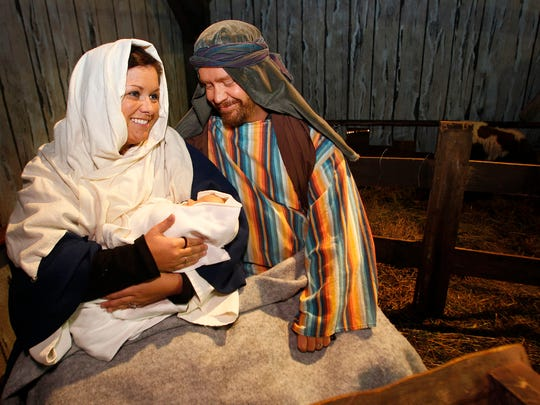 Joseph and Mary hold the baby Jesus in the manger during a past Living Nativity presentation at Faith Church.
