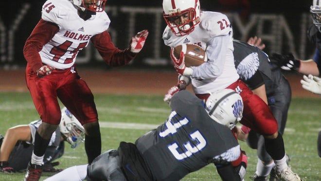 Scott's Alex Thurza tackles Henderson of Holmes.  Scott 9, Holmes 6. Football. KHSAA. Oct. 21, 2016. Scott HS. Taylor Mill KY.