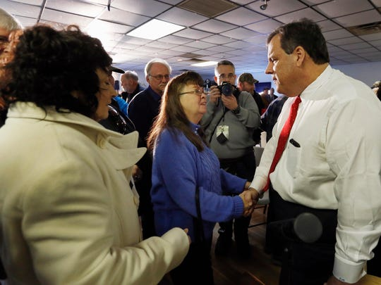 Republican presidential candidate, Ohio Gov. Chris Christie shakes hands during a campaign stop, Tuesday, Feb. 2, 2016, in Epping, N.H. (AP Photo/Jim Cole)