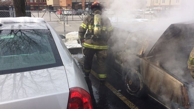 Firefighters work on the scene of a car fire Friday in York.