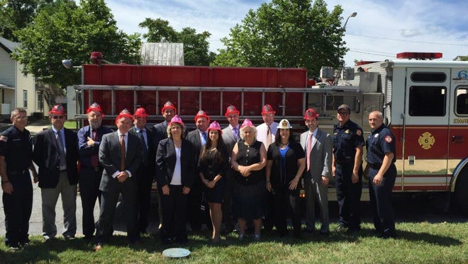 VINELAND - (From left) Firefighter Dan Durand; Al Lupcho and Rich Catrambone, financial advisers; Rob McAllister, branch manager; Wayne Campbell and John Fitzgerald, financial advisers; Carol Doran-Timmins, complex risk officer; Charles Allen, financial adviser; Jenna Biagi, client service associate; Mike Ahrens, financial adviser; Maria Grant, client service associate; and Jack Whiteway, Vanessa Brown and Steve Caltabiano, financial advisers; fire Capt. Mark Cifaloglio; and firefighter Chuck Nash were present as Morgan Stanley Wealth Management's Vineland branch presented a check for $150 to the Vineland Fire Department on June 30. The money was raised by charging employees to participate in the branch's Casual Fridays program. Firefighters Dan Walters and Sarah Viruet are not pictured.