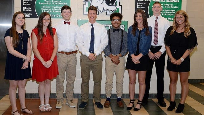 Pictured left to right: Hannah Schorsch (golf, Mt. Saint Joseph), Brandi Garcia (softball, Miami-Hamilton), Drew Banks (football, Hanover), Evan Miller (baseball, Xavier), Milus Hearn-Sutton (soccer, Defiance), Madison Huber (softball, Cumberland's), Jacob Back (basketball, Rose-Hulman Institute of Technology), Erin Stevens (soccer, Cleveland State) stand side-by-side after committing to their respective college athletic squads.