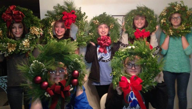 Thisphotogreeting comes from the Nuts About Nature junior gardeners, who have framed their faces within fresh wreaths made for the holidays during their December workshop meeting. From left, front, areChloe Radcliff, and Abi Chester; and back,Natalie Goldfuss, Alissa Goldfuss, Clareese Prenger, Paige Smith andKatelynn Reynolds.