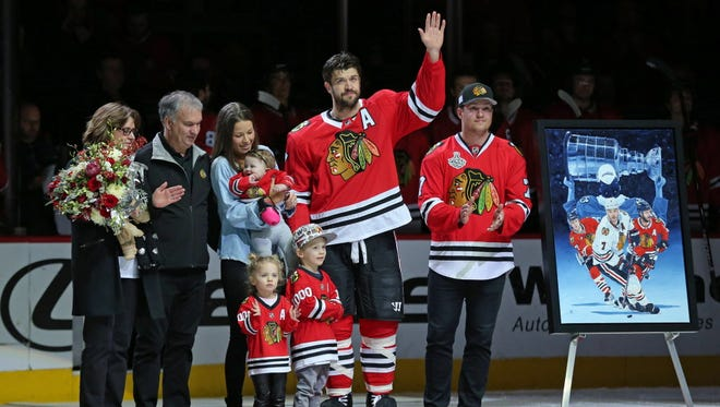 Chicago Blackhawks defenseman Brent Seabrook (7) is honored for playing in his 1,000th game.