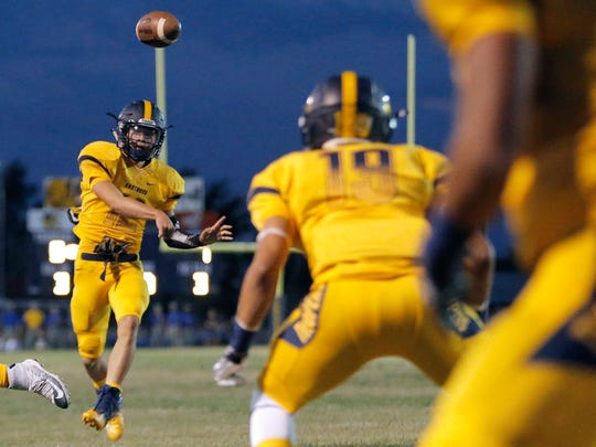 Eastwood senior quarterback Mark Torrez throws a pass to senior wide receiver Heber Ovalles in a district opener game versus Americas last September.