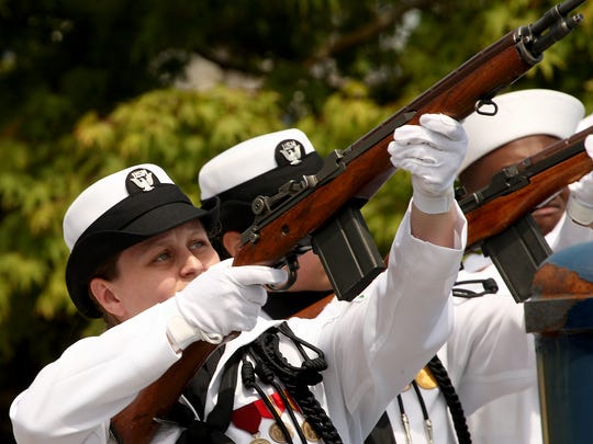 Navy sailors perform a 21-gun salute during the Battle of Midway ceremony on Tuesday.